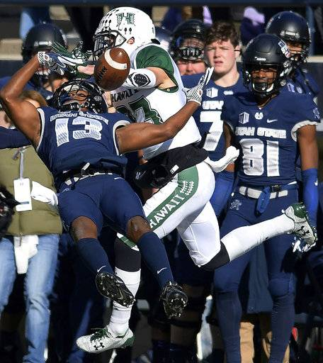 Utah State cornerback Jalen Davis (13) breaks up a pass intended for Hawaii wide receiver Dylan Collie (23) during an NCAA college football game, Saturday, Nov. 18, 2017, in Logan, Utah. Utah State won 38-0. (Eli Lucero/The Herald Journal via AP)
