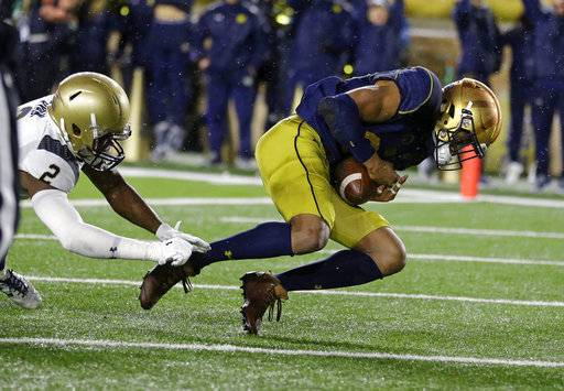Notre Dame wide receiver Kevin Stepherson (29) makes a catch in the end zone for a touchdown in front of Navy safety Jarid Ryan (2) during the second half of an NCAA college football game in South Bend, Ind., Saturday, Nov. 18, 2017. Notre Dame defeated Navy 24-17. (AP Photo/Michael Conroy)