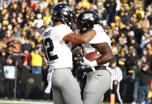 Purdue running back D.J. Knox, right, celebrates with teammate Jared Sparks after catching a 5-yard touchdown pass during the first half of an NCAA college football game against Iowa, Saturday, Nov. 18, 2017, in Iowa City, Iowa. (AP Photo/Charlie Neibergall)