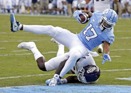 North Carolina's Anthony Ratliff-Williams (17) scores a touchdown while Western Carolina's Shamon Elliott tackles during the first half of an NCAA college football game in Chapel Hill, N.C., Saturday, Nov. 18, 2017. (AP Photo/Gerry Broome)