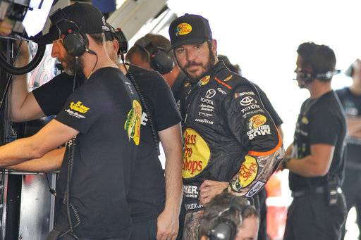 Martin Truex Jr. Martin Truex Jr. looks in his car during practice for Sunday's NASCAR Cup Series auto race at Homestead-Miami Speedway in Homestead, Fla. (AP Photo/Gaston De Cardenas)