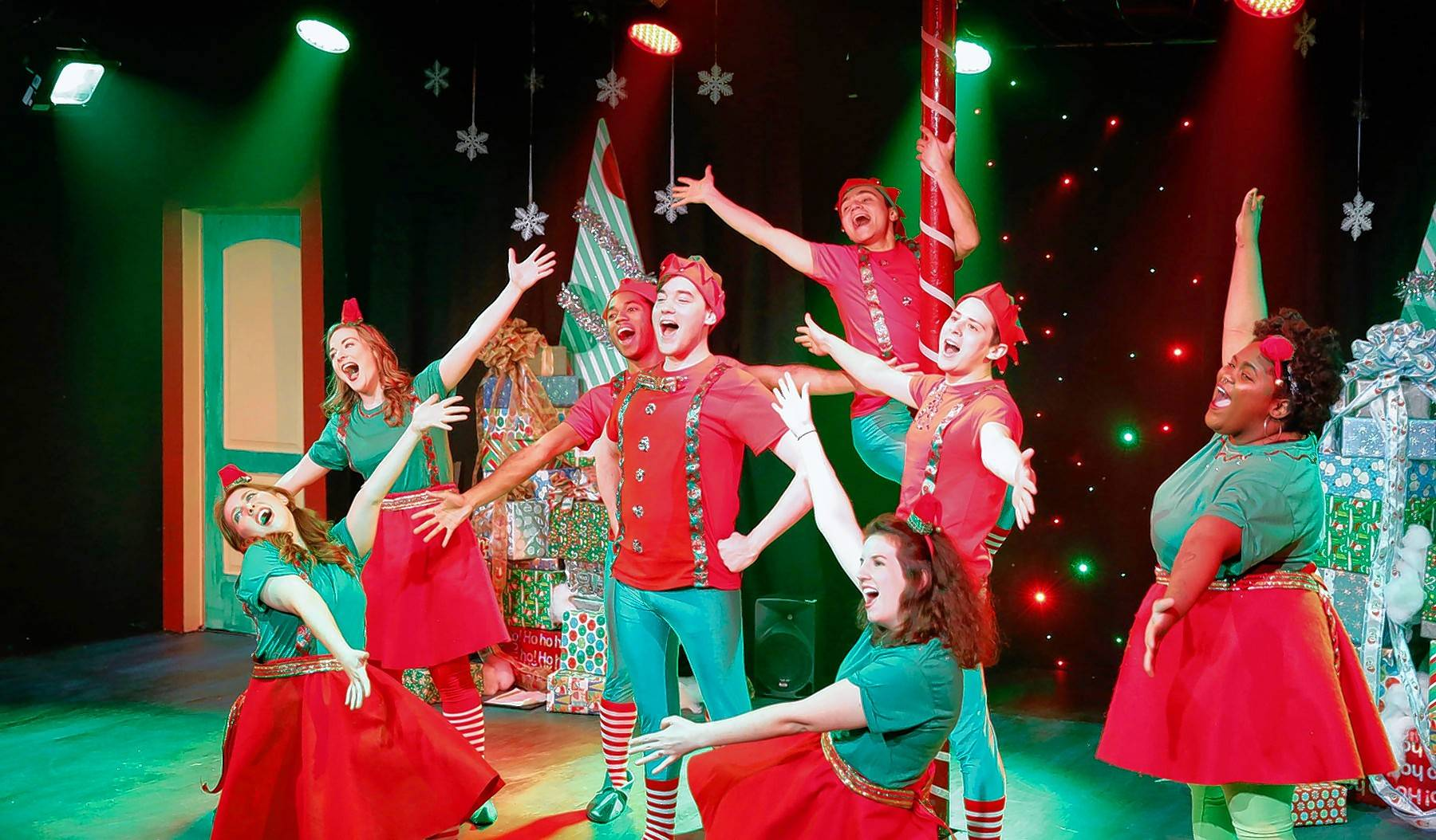 "Bryan Renaud, center, played the title character last year in the 2016 production of ""Barney the Elf."" The Sugar Grove native wrote the adult musical parody, which returns to Chicago."
