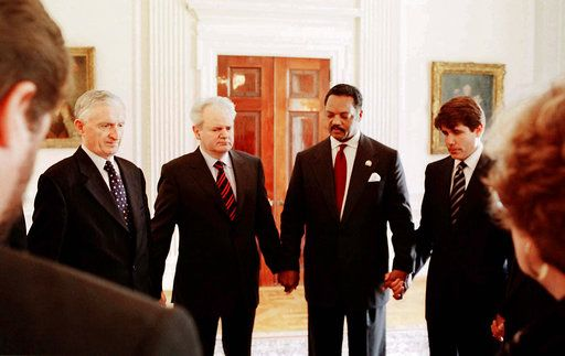 "FILE - In this Saturday, May 1, 1999 file photo, U.S. Rev. Jesse Jackson, second from right, holds hands as he leads a prayer with Yugoslav President Slobodan Milosevic, second from left, Yugoslav Minister of Foreign Affairs Zivadin Jovanovic, left, and U.S. Rep. Rod Blagojevich, D-Ill., right, in Belgrade. Milosevic agreed Saturday to release three American soldiers captured the previous month and would be handed over to Jackson as part of his ""peace effort,'' the state-run Tanjug news agency said. (John H. White/Chicago Sun-Times via AP, Pool)"