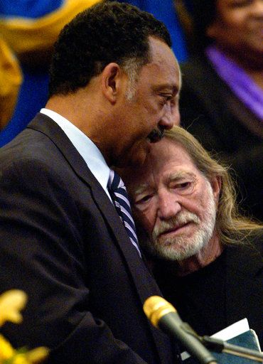 "After singing ""Georgia On My Mind,"" Willie Nelson and the Rev. Jesse Jackson embrace during funeral services for Ray Charles at First AME Church in Los Angeles Friday, June 18, 2004."