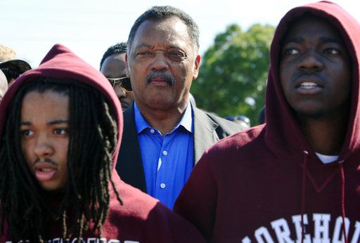 FILE - In this Monday, March 26, 2012 file photo, Rev. Jesse Jackson leads a rally as thousands of supporters march for Trayvon Martin, the black teen shot by George Michael Zimmerman while on neighborhood watch patrol, in Sanford, Fla.