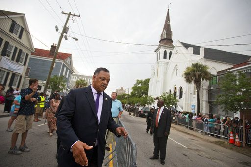FILE - In this Thursday, June 25, 2015 file photo, the Rev. Jesse Jackson arrives for the wake of Sen. Clementa Pinckney, one of the nine killed in the previous week's mass shooting at Emanuel AME Church in Charleston, S.C. Dylann Roof, 21, shot and killed nine African-American church members during a Bible study group. Police contend the attack was racially motivated. Roof has been sentenced to death in the shootings.