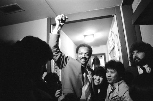 FILE - In this Tuesday, May 15, 1984 file photo, Rev. Jesse Jackson arrives at the home of June and Luz Texon in Daly City, Calif., following a day of California campaigning. The presidential candidate spent the night at the couples home.