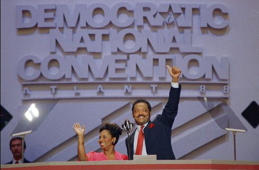 FILE - In this July 20, 1988 file photo, Rev. Jesse Jackson and his wife, Jacqueline, acknowledge the cheers of delegates and supporters before his emotional speech to the Democratic National Convention in Atlanta.