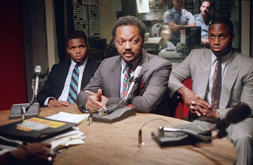 FILE - In this Aug. 29, 1988 file photo, Rev. Jesse Jackson, center, is flanked by sons Jonathan, left, and Jesse Luther Jr., as he makes a guest appearance on radio station WLIB in New York.