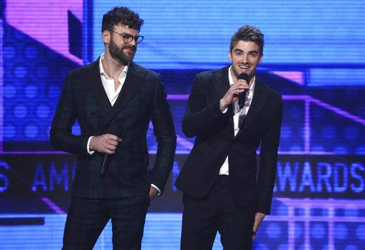 Alex Pall, left, and Andrew Taggart of The Chainsmokers introduce a performance by BTS at the American Music Awards at the Microsoft Theater on Sunday, Nov. 19, 2017, in Los Angeles. (Photo by Matt Sayles/Invision/AP)
