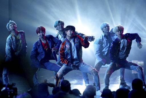 "BTS performs ""DNA"" at the American Music Awards at the Microsoft Theater on Sunday, Nov. 19, 2017, in Los Angeles. (Photo by Matt Sayles/Invision/AP)"