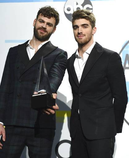 Alex Pall, left, and Andrew Taggart of The Chainsmokers pose in the press room with the award for favorite artist electronic dance music at the American Music Awards at the Microsoft Theater on Sunday, Nov. 19, 2017, in Los Angeles. (Photo by Jordan Strauss/Invision/AP)
