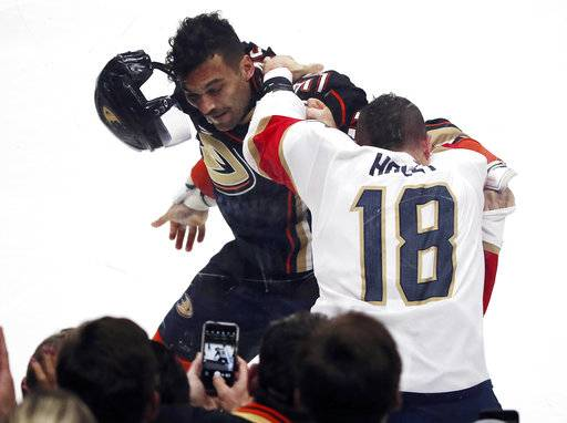 Florida Panthers center Micheal Haley (18) and Anaheim Ducks left winger Mike Liambas (52) fight in the first period of an NHL hockey game in Anaheim, Calif., Sunday, Nov. 19, 2017.