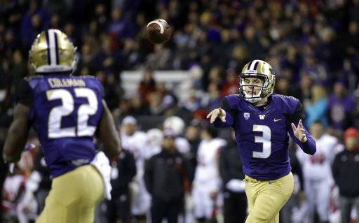 Washington quarterback Jake Browning (3) throws a pass to Lavon Coleman for a 6-yard touchdown against Utah during the first half of an NCAA college football game Saturday, Nov. 18, 2017, in Seattle.