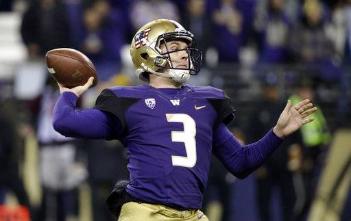 Washington quarterback Jake Browning drops back to pass against Utah during the first half of an NCAA college football game Saturday, Nov. 18, 2017, in Seattle.