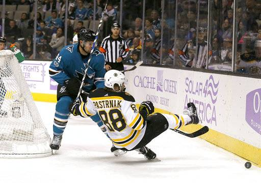 Boston Bruins right wing David Pastrnak (88), of the Czech Republic, collides with San Jose Sharks defenseman Marc-Edouard Vlasic (44) during the first period of an NHL hockey game Saturday, Nov. 18, 2017, in San Jose, Calif.