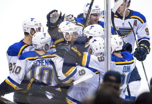 St. Louis Blues' Brayden Schenn (10) and teammates celebrate his overtime goal against the Vancouver Canucks during an NHL hockey game Saturday, Nov. 18, 2017, in Vancouver, British Columbia. (Darryl Dyck/The Canadian Press via AP)