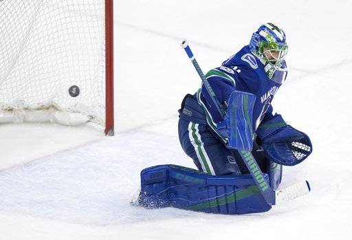 Vancouver Canucks goalie Anders Nilsson, of Sweden, allows the winning goal to St. Louis Blues' Brayden Schenn during overtime of an NHL hockey game Saturday, Nov. 18, 2017, in Vancouver, British Columbia. (Darryl Dyck/The Canadian Press via AP)