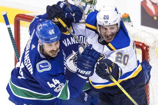 Vancouver Canucks' Erik Gudbranson (44) checks St. Louis Blues' Alexander Steen (20) during the third period of an NHL hockey game Saturday, Nov. 18, 2017, in Vancouver, British Columbia. (Darryl Dyck/The Canadian Press via AP)
