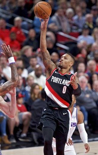 Portland Trail Blazers guard Damian Lillard shoots against the Sacramento Kings during the second half of an NBA basketball game in Portland, Ore., Saturday, Nov. 18, 2017.
