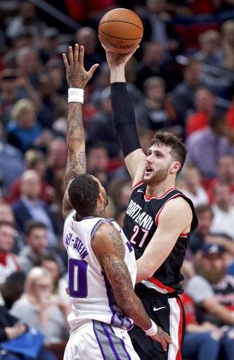 Portland Trail Blazers center Jusuf Nurkic, right, shoots over Sacramento Kings center Willie Cauley-Stein during the second half of an NBA basketball game in Portland, Ore., Saturday, Nov. 18, 2017.
