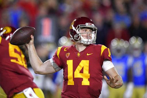 Southern California quarterback Sam Darnold passes during the first half of an NCAA college football game against the UCLA, Saturday, Nov. 18, 2017, in Los Angeles.