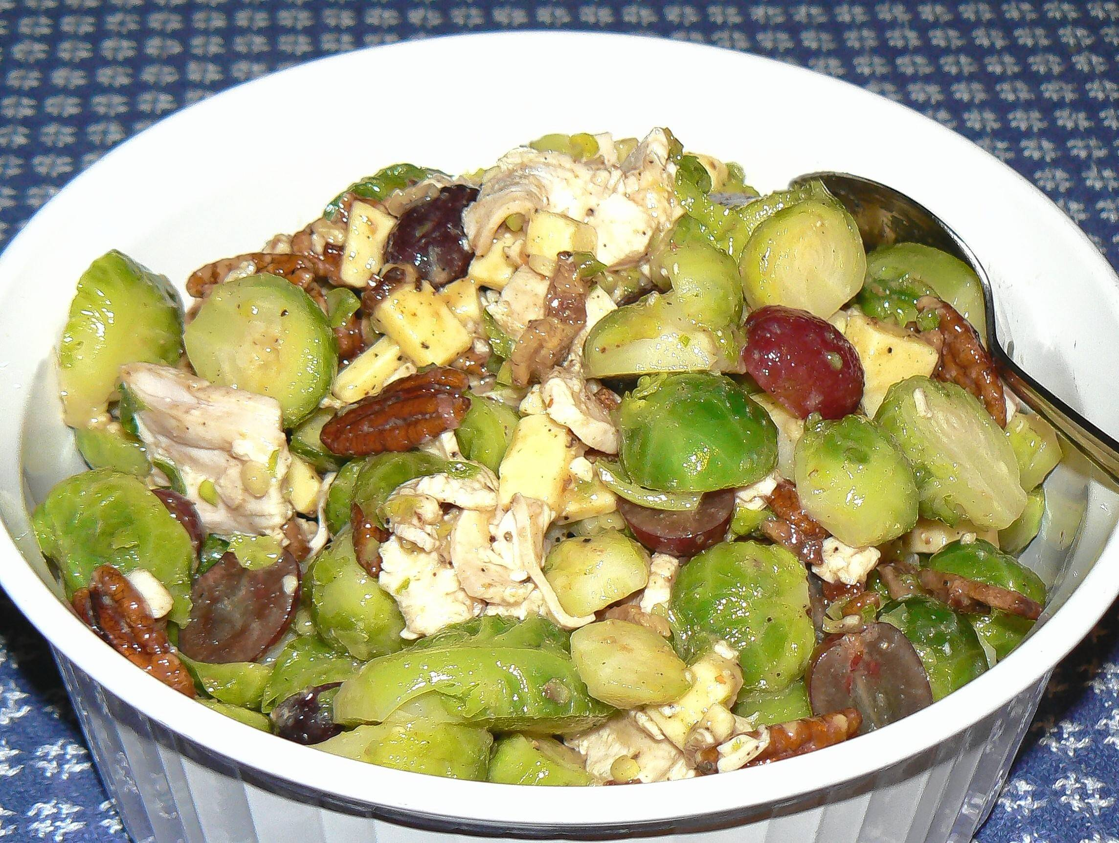 Leftover turkey meets seedless grapes, Brussels sprouts and toasted pecans in this post-Thanksgiving salad.