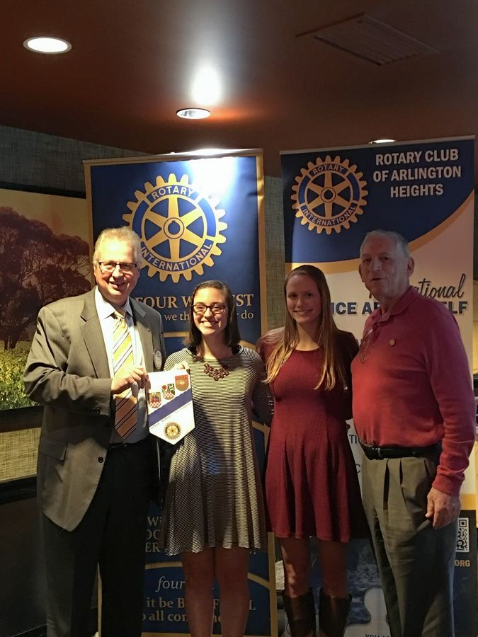 Arlington Heights Rotary Club President Jim Thomson, left, displays the Rotary flag brought back from Altena, Germany, by Lauryn Lintner, second from left. Also pictured are Lauryn's grandfather, Mike Silverman, and Christina Ruterschmidt.