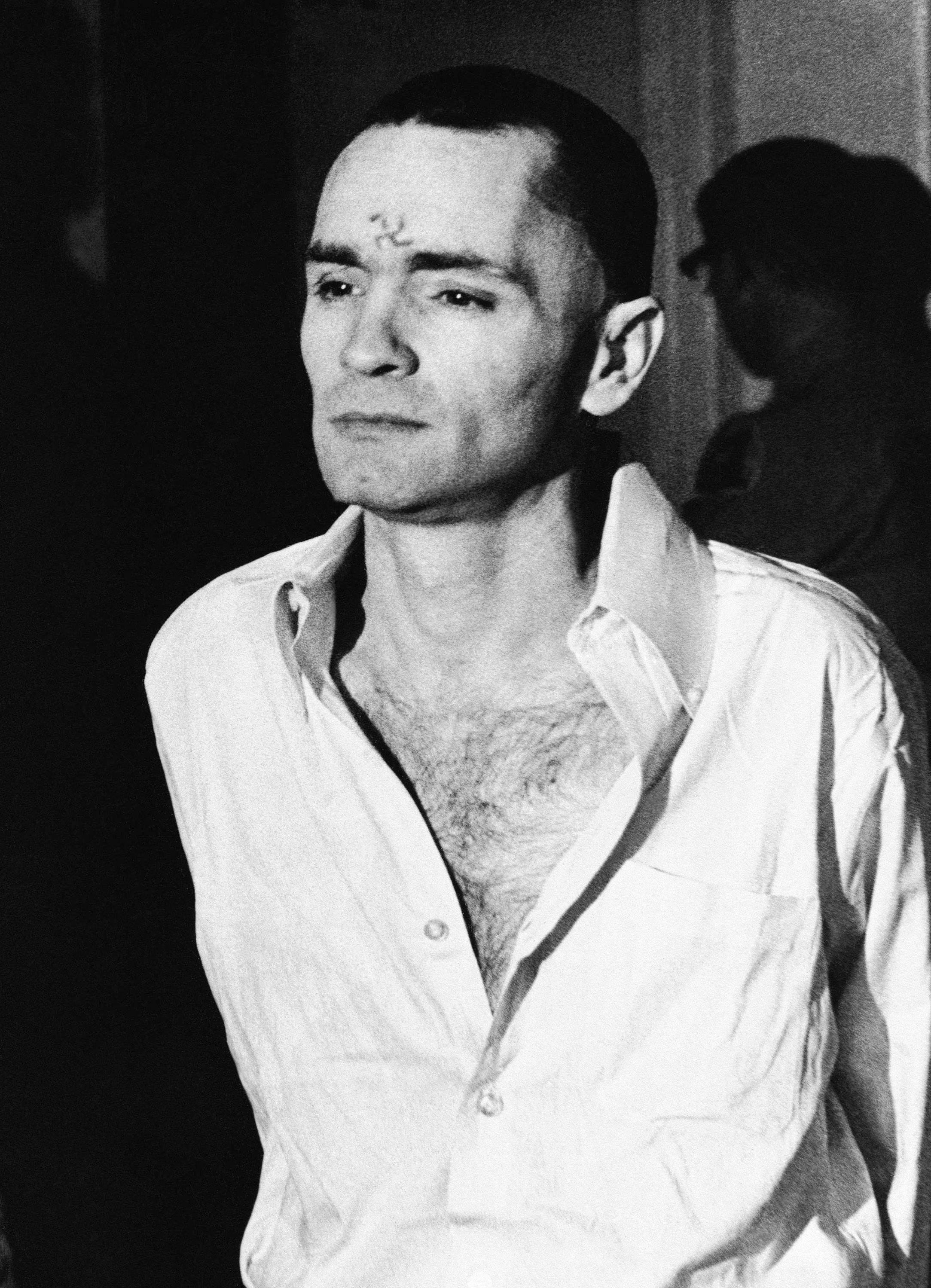 FILE - In this March 12, 1971 file photo, Charles Manson, with a swastika on his forehead, walks to court in Los Angeles, during the the penalty phase of the Sharon Tate trial after being convicted of murder in the deaths of Tate and six others. Authorities say Manson, cult leader and mastermind behind 1969 deaths of actress Sharon Tate and six others, died on Sunday, Nov. 19, 2017. He was 83.