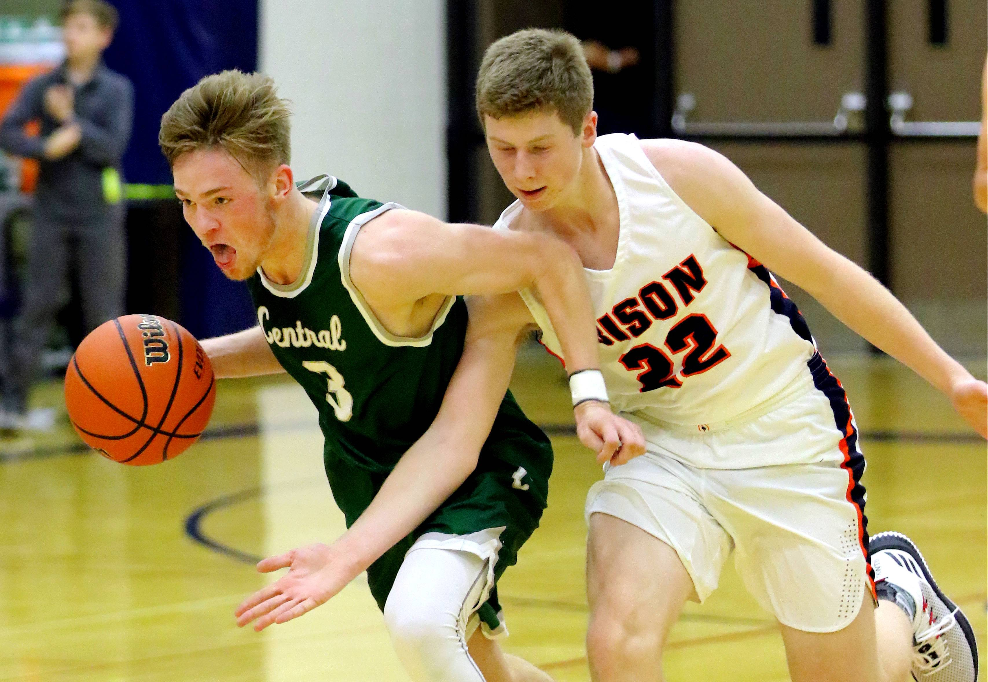 Grayslake Central's Alec Novak, left, drives past Buffalo Grove's Nathan Cole on Monday night at Buffalo Grove.