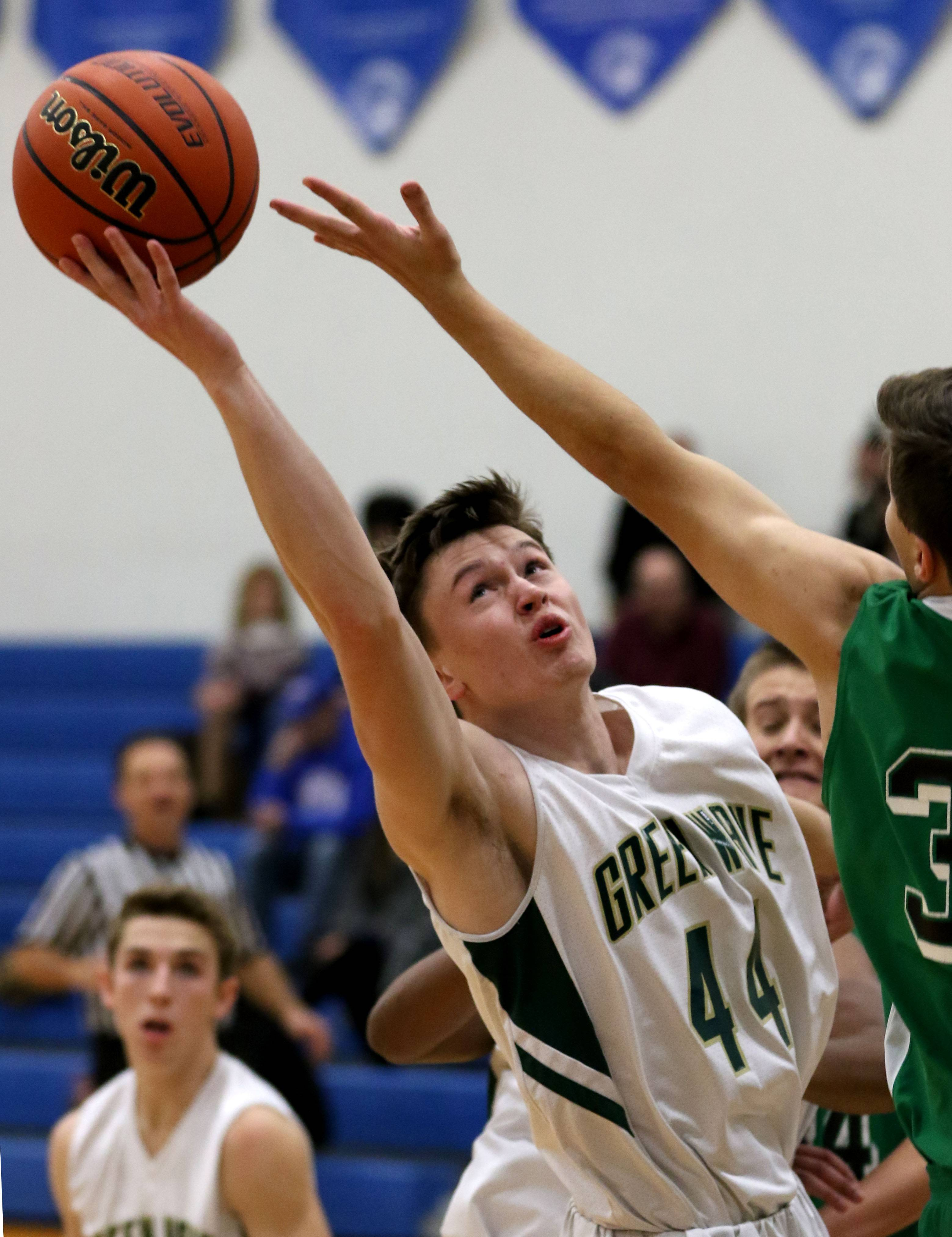 St. Edward's Collan O'Neill grabs a rebound in front of Alden-Hebron's Kyle Judson on Monday in boys varsity basketball action at the 11th Annual Westminster Christian Thanksgiving Tournament.