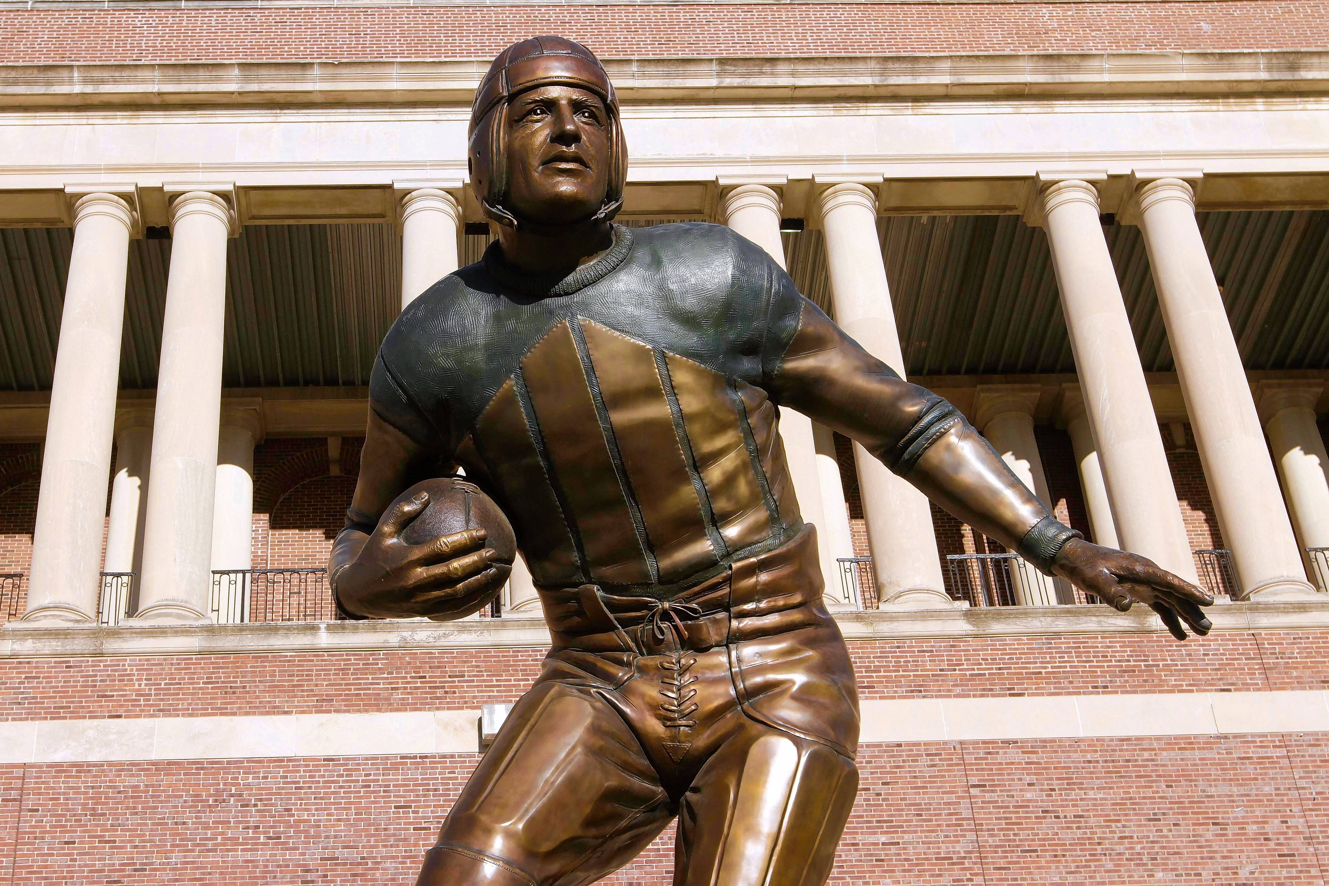 This statue of Red Grange, seen outside of Memorial Stadium, the home of the University of Illinois Fighting Illini, was designed by an artist who also has been commissioned to create one to honor Dick Butkus.