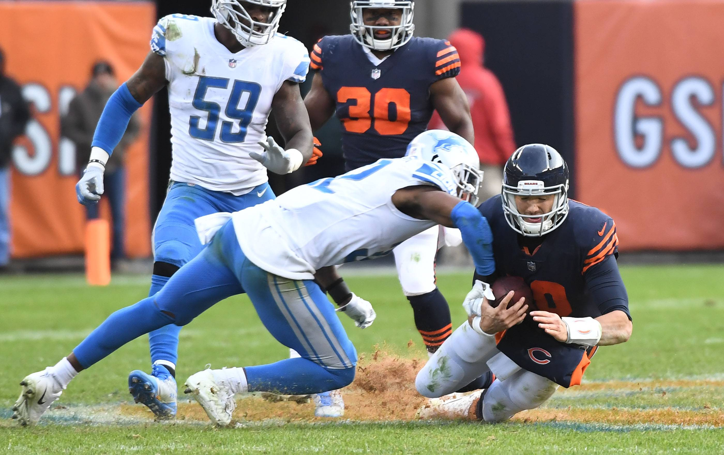 Chicago Bears quarterback Mitchell Trubisky dives for a first down as he takes a hit from Detroit Lions strong safety Tavon Wilson on the last drive of the game Sunday at Soldier Field in Chicago.