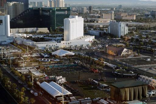 FILE - In this Oct. 3, 2017, file photo, debris litters a festival grounds across the street from the Mandalay Bay resort and casino in Las Vegas. Attorneys who filed one of the first lawsuits after the Oct. 1 mass shooting that killed dozens concert-goers and left hundreds injured on the Las Vegas Strip filed four new negligence cases Monday, Nov. 20, on behalf of more than 450 victims.