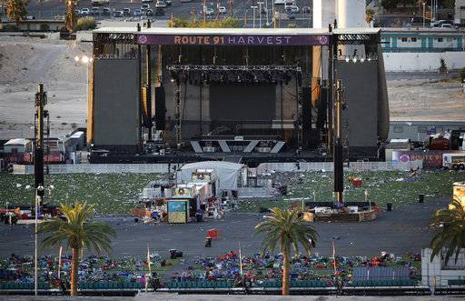 FILE - In this Oct. 3, 2017, file photo, debris litters a concert festival grounds after a mass shooting in Las Vegas. Attorneys who filed one of the first lawsuits after the Oct. 1 mass shooting that killed dozens of concert-goers on the Las Vegas Strip filed four new negligence cases Monday, Nov. 20, on behalf of more than 450 victims.