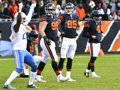Chicago Bears kicker Connor Barth, right, bows his head as teammates Mitch Unrein and Daniel Brown watch Detroit Lions strong safety Don Carey, front left, celebrate a missed field goal with only seconds left in regulation of an NFL football game Sunday, Nov. 19, 2017, in Chicago. (John Starks/Daily Herald via AP)