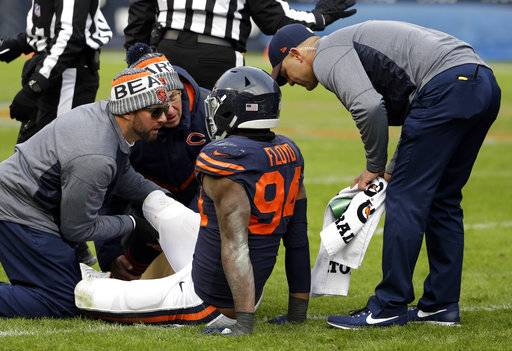Trainers check on Chicago Bears outside linebacker Leonard Floyd (94) during the second half of an NFL football game against the Detroit Lions, Sunday, Nov. 19, 2017, in Chicago.