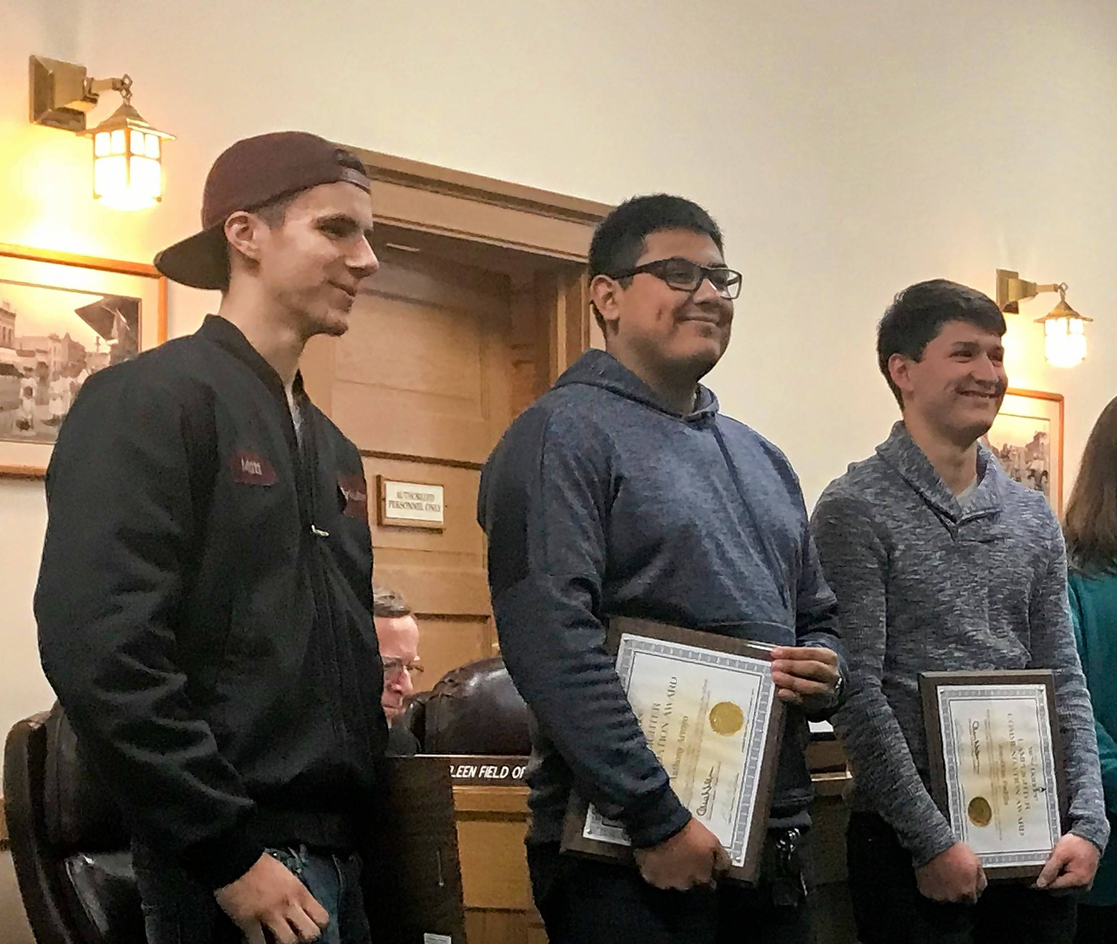 When a baby fell out of a moving vehicle in West Dundee last month, 17-year-old Matthew Gillespie, left, called 911, while Anthony Arroyo, 18, ran into the intersection to care for the child, and Jonathan Padilla, 17, chased after the vehicle responsible.