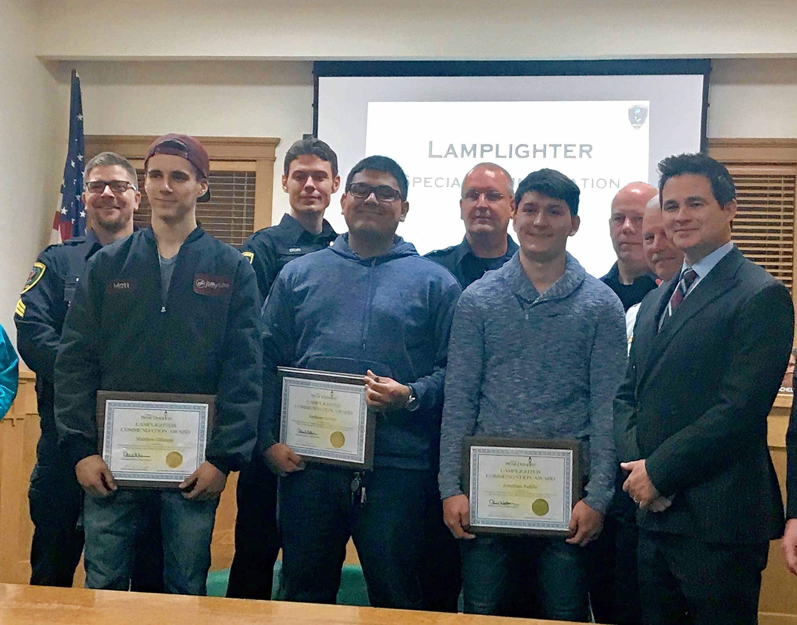 Matthew Gillespie, front left, Anthony Arroyo and Jonathan Padilla were honored by West Dundee officials Monday for saving the life of a 1-year-old who fell out of a moving vehicle.