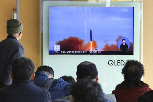 "People watch a TV screen showing file footage of North Korea's missile launch at Seoul Railway Station in Seoul, South Korea, Tuesday, Nov. 21, 2017. U.S. President Donald Trump announced Monday the U.S. is putting North Korea's ""murderous regime"" on America's terrorism blacklist, despite questions about Pyongyang's support for international attacks beyond the assassination of its leader's half brother in February. (AP Photo/Ahn Young-joon)"