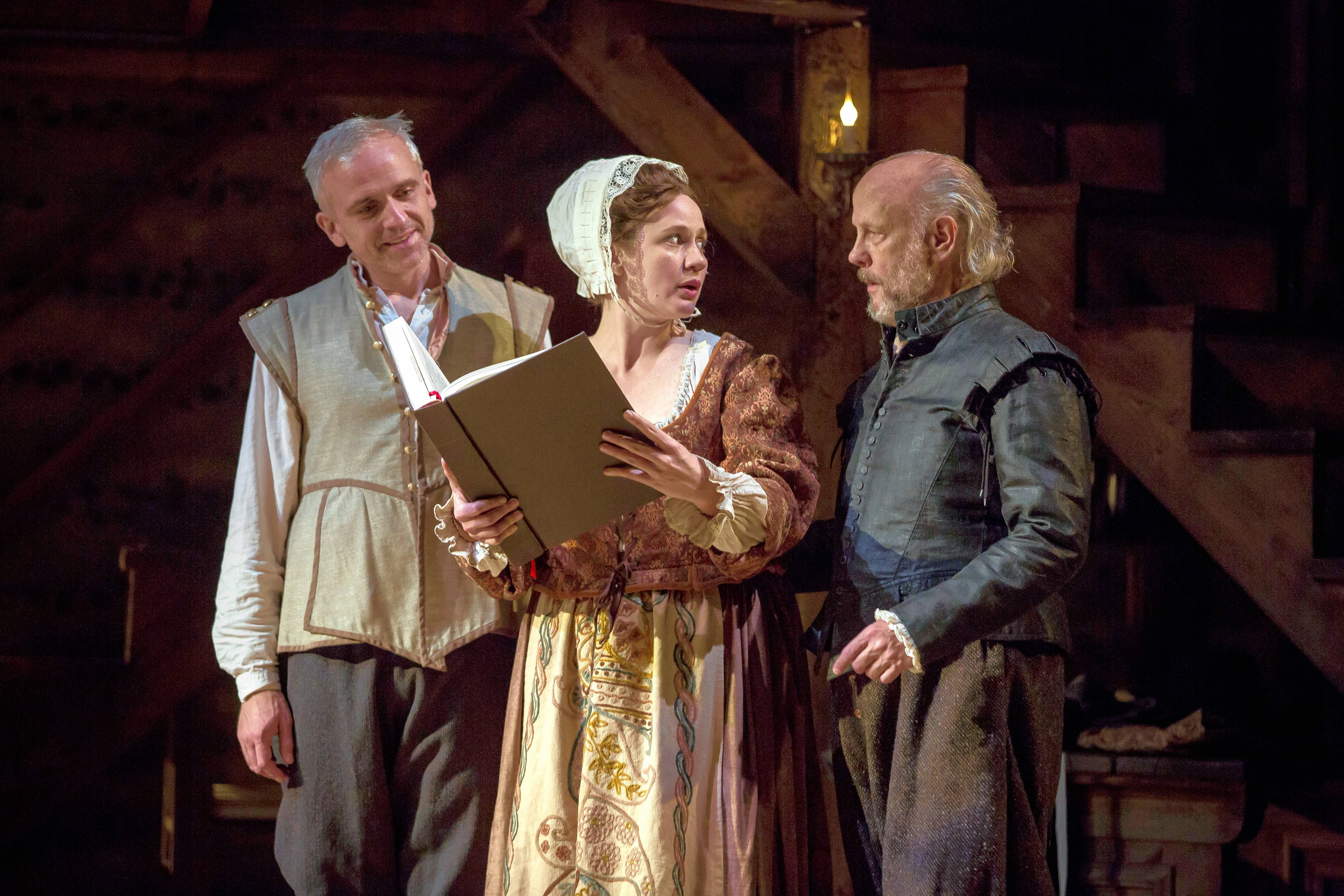 "Henry Condell (Gregory Linington), Susannah Shakespeare (Dana Black) and John Heminges (Jim Ortlieb) look at the First Folio of Shakespeare's plays in the Midwest premiere of Lauren Gunderson's ""The Book of Will"" at Northlight Theatre in Skokie."