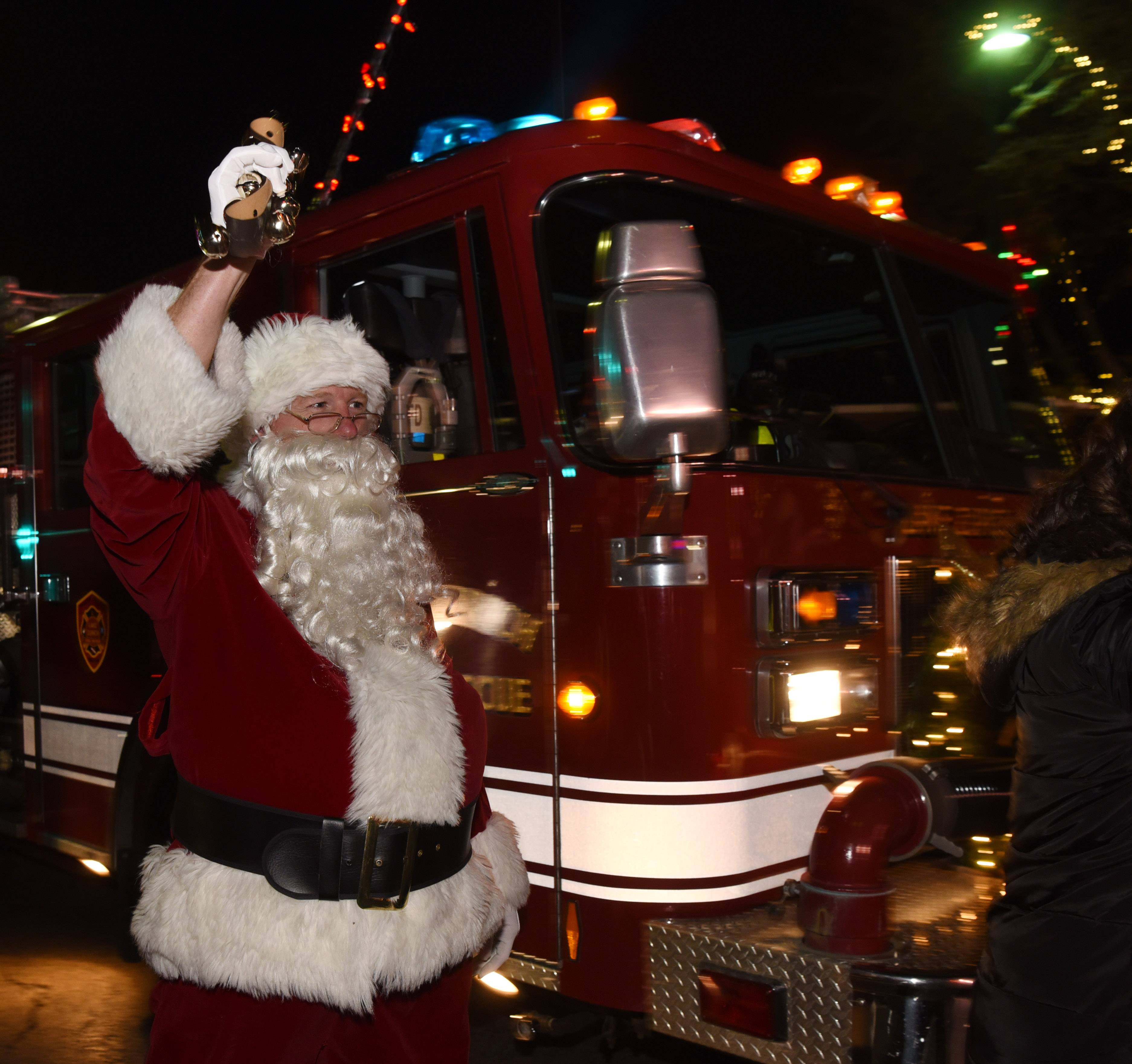 Santa Claus arrives by fire truck during the Miracle on Main Street event at Rotary Park in downtown Lake Zurich.