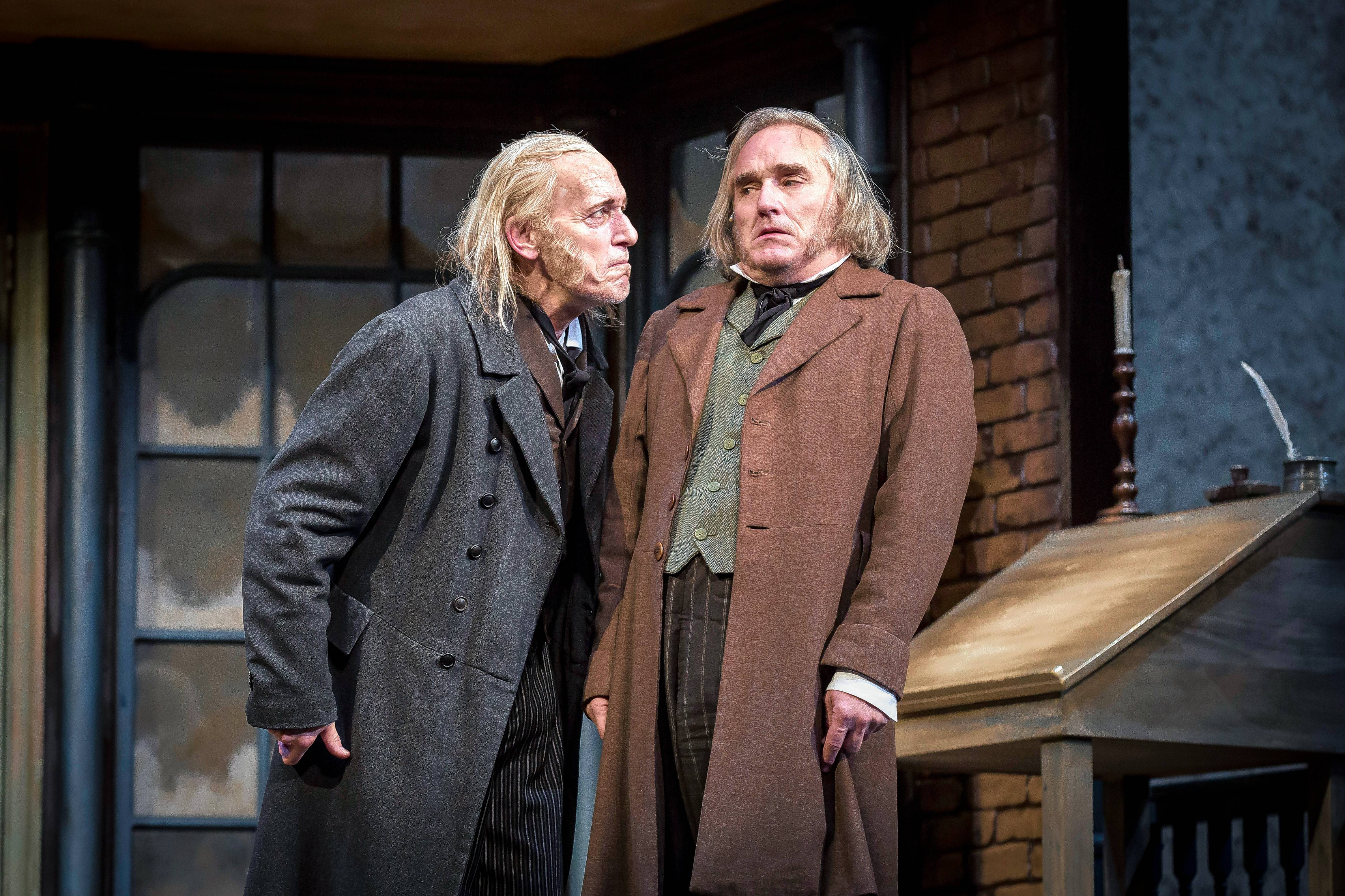 "Larry Yando, left, and Ron E. Rains reprise their roles as Ebenezer Scrooge and Bob Cratchit in Goodman Theatre's 40th annual production of Charles Dickens' ""A Christmas Carol."""