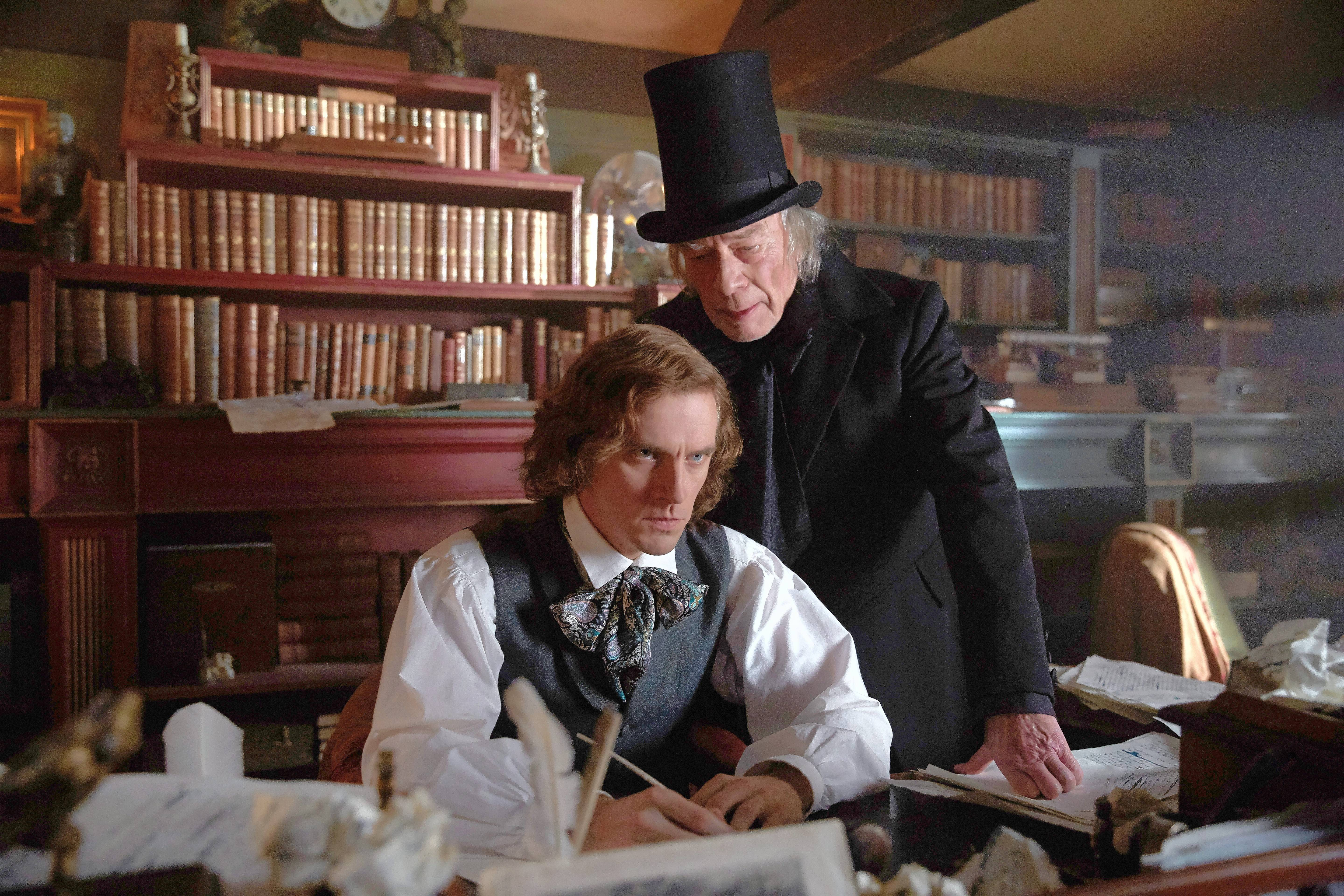 "Novelist Charles Dickens (Dan Stevens) banters with his dark and dour muse Ebenezer Scrooge (Christopher Plummer) to create ""A Christmas Carol"" during ""The Man Who Invented Christmas."""