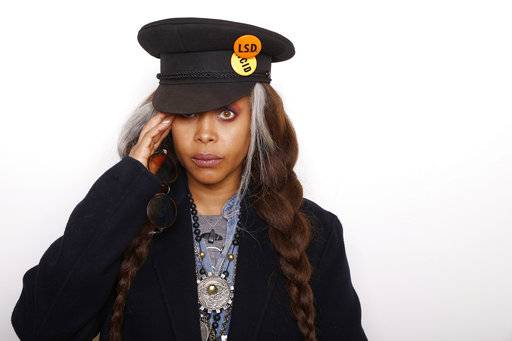 "FILE - In this Jan. 25, 2016 file photo, musician and Actress Erykah Badu poses for a portrait to promote the film, ""The Land"", during the Sundance Film Festival in Park City, Utah. On Sunday, Badu will host the Soul Train Awards on BET. (Photo by Matt Sayles/Invision/AP, File)"