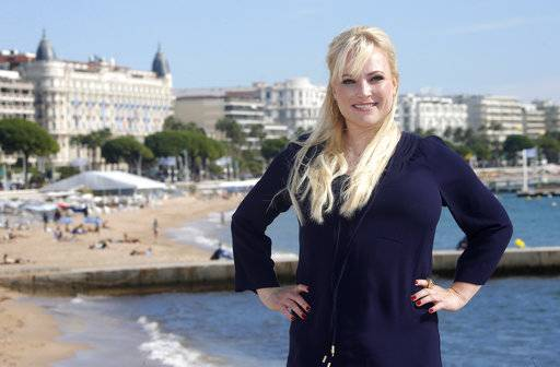FILE - In this Oct. 8, 2013, file photo, conservative commentator Meghan McCain poses during a photocall at the 29th MIPCOM (International Film and Programme Market for TV, Video, Cable and Satellite) in Cannes, France. McCain's father, U.S. Sen. John McCain, announced on Nov. 22, 2017, that his daughter married fellow conservative commentator Ben Domenech at the family's ranch in Arizona the day before. (AP Photo/Lionel Cironneau, File)