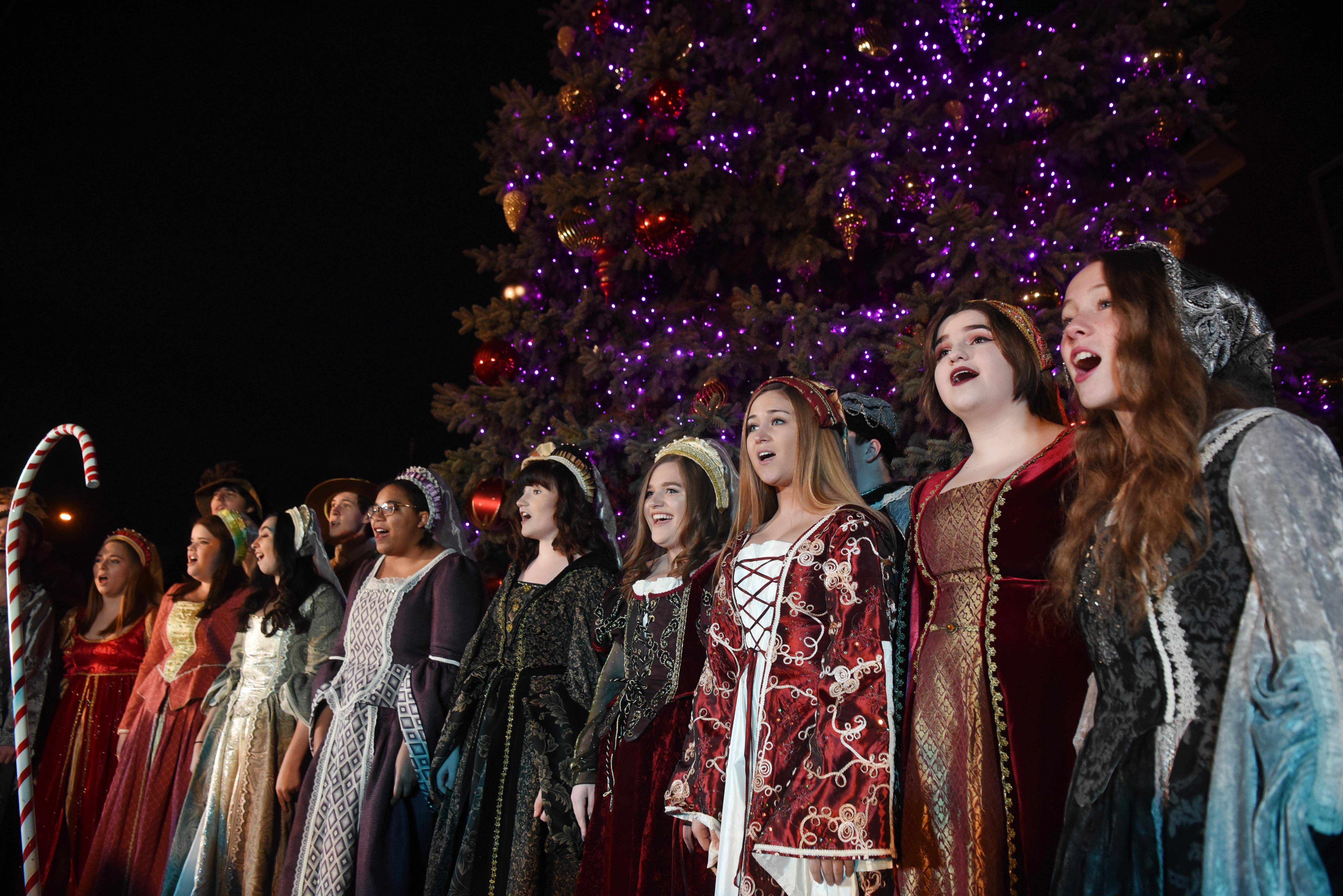 The Prospect High School Madrigal Singers perform during the Mount Prospect tree-lighting ceremony Wednesday near village hall.