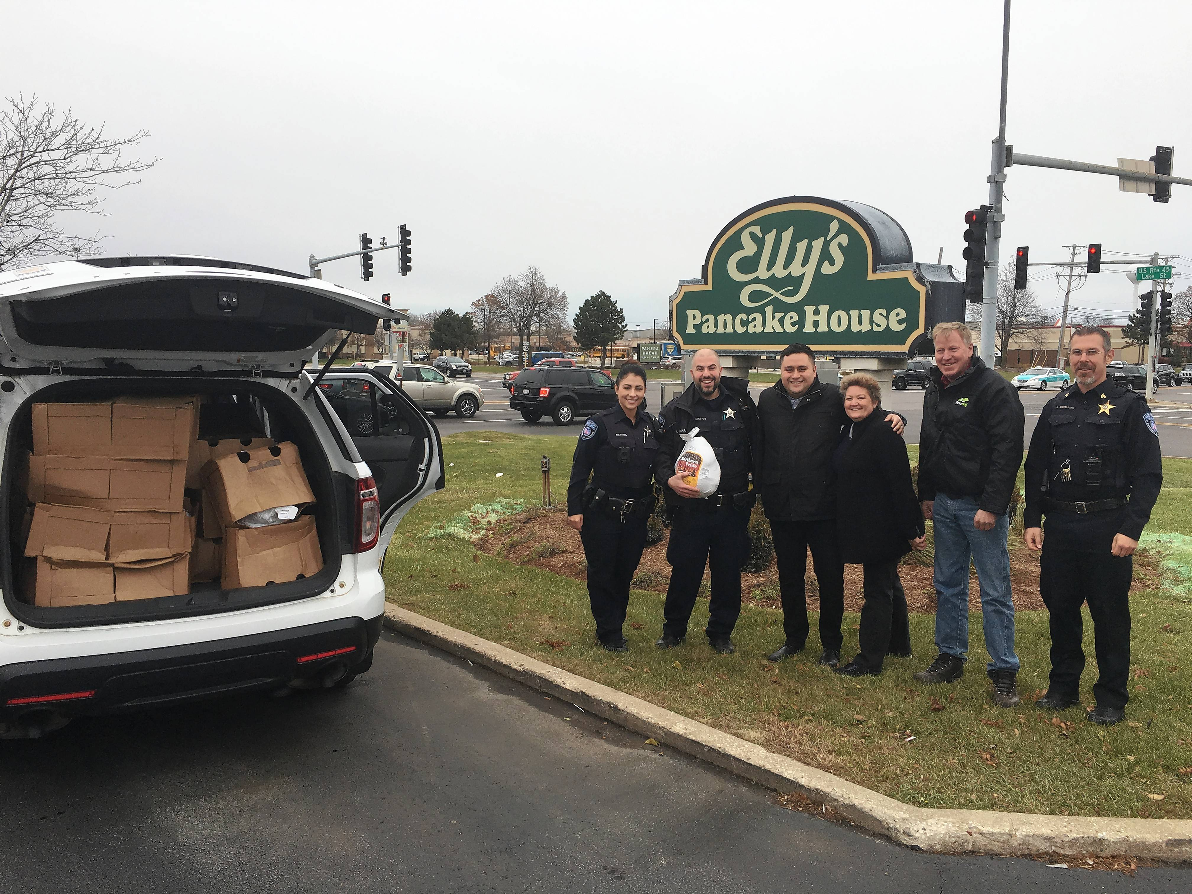 "Mundelein police teamed with Elly's Pancake House to put together Thanksgiving meals that were delivered Tuesday to 40 needy families in the community. ""It's just a great feeling to give back to the community and help those who need it,"" Mundelein Public Safety Director Eric Guenther said."