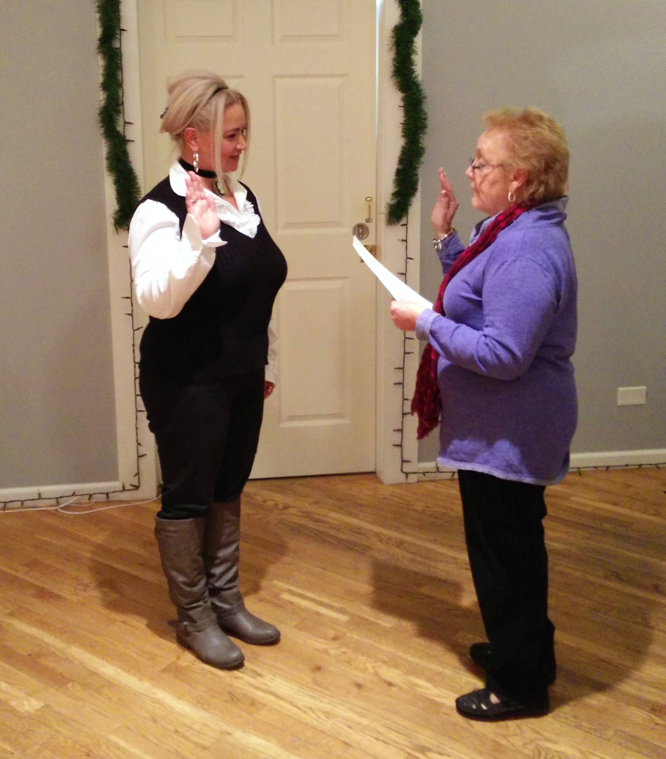 Sophia Boyer, left, was sworn in as a village trustee Tuesday by Round Lake Park Mayor Linda Lucassen.