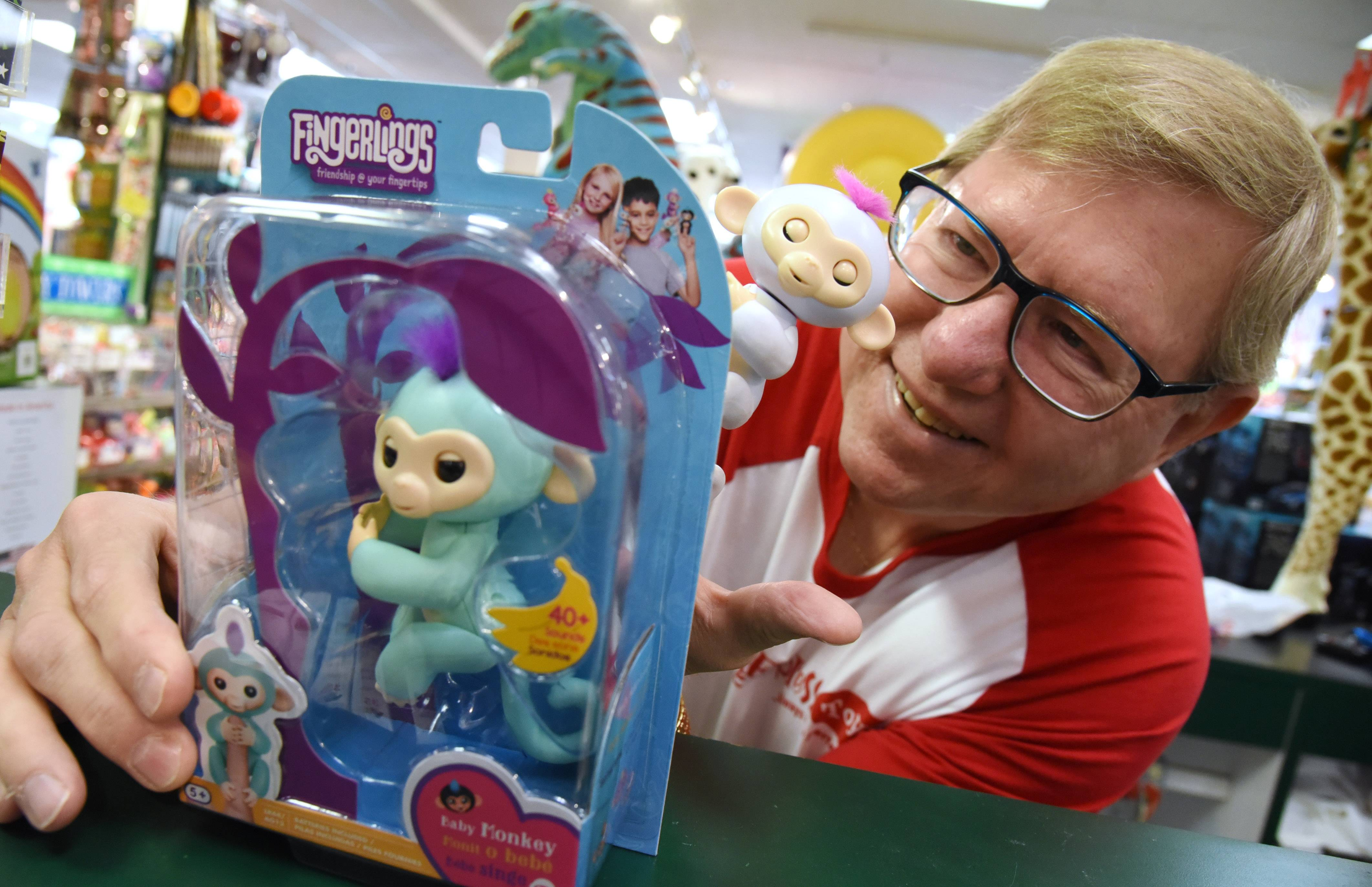 Lake Zurich Learning Express owner Richard Derr shows off one of this season's hottest new toys, the Fingerlings.
